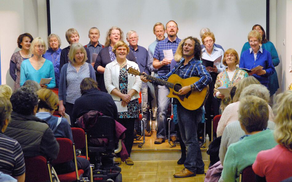 Jed Milroy gets the audience singing along. Photo credit Sheila Masson Photography
